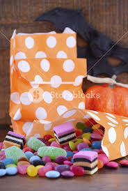 halloween candy trick or treat bags with colorful candy pumpkin