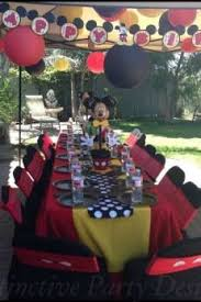 mickey mouse chair covers chair cover at a mickey mouse clubhouse themed birthday party via