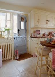 Cottage Kitchen Accessories - cream sunlit country kitchen with pink accessories and pastel blue