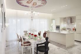 luxury white finished dining table set and centerpieces decors as