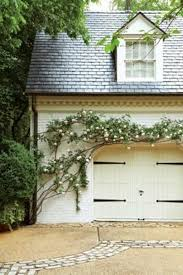 Cottage Style Garage Doors by The Look For Less Carriage Garage Door Shades Of Blue Interiors