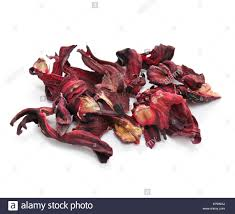 dried hibiscus flowers a pile of dried hibiscus flowers for cooking on a white background