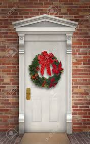 christmas wreath hanging on a traditional wooden door stock photo
