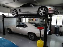 garage car lift home design by larizza 12 photos gallery of outdoor garage car lift