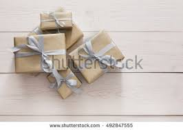 silver boxes with bows on top top view gift boxes on white stock photo 569222485