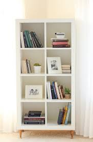 billy bookcase corner unit 10 diy ikea hacks for a home library or a reading nook shelterness