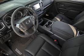nissan cummins interior 2018 nissan frontier and nissan titan go dark with midnight