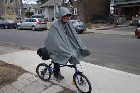cycling rain gear some thoughts on the cleverhood bicycle rain cape biking in a