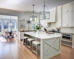 white kitchen with gray center island and backless gray wood