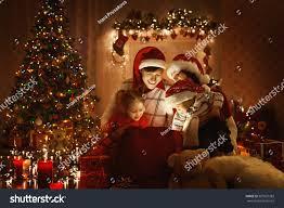 christmas family open present gift bag stock photo 507827383