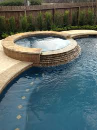 Swimming Pools Backyard by Inground Swimming Pool Tile Raised Spa Stacked Stone Spa Spillway