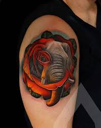 lovely arm tattoo of red rose and elephant for men goluputtar com