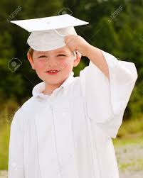 cap and gown for preschool boy with cap and gown for preschool graduation stock photo