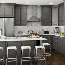 grey kitchen cabinets with brown wood floors 75 beautiful l shaped kitchen with a peninsula pictures