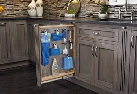 how do you fill the gap between kitchen cabinets and ceiling how to install a pullout organizer bob vila