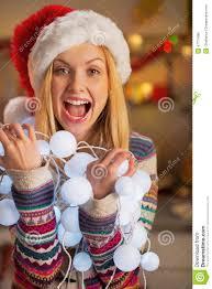 teenager holding tangled christmas lights stock photo image