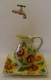 84 best sunflower items images on pinterest sunflowers sunflower water fountain with illusion by phantomfountains