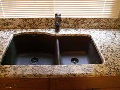 new venetian gold granite w granite backsplash laundry room