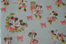 minnie mouse christmas wrapping paper disney wrapping tips to create magical packaging mouse ears