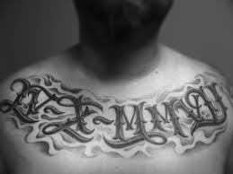 roman numeral lettering tattoo on chest real photo pictures
