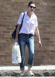 julianna margulies in white shirt and jeans while grocery shopping