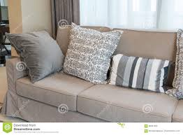 Sofas With Pillows by Brown Sofa With Grey Patterned Pillows Stock Photo Image 66341497
