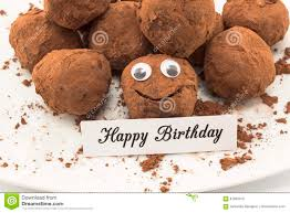 happy birthday card with smiley chocolate truffles stock image