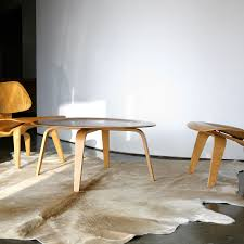 decor cow skin rug with modern table and chairs on wooden floor