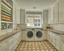 interior seamless laundry room idea with concrete cabinets and