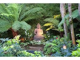 buddha statue in garden setting landscaping garden