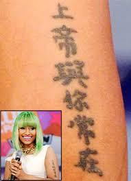 nicki minaj tattoo her left arm means pictures to pin on pinterest