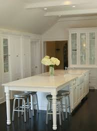 tall white kitchen table kitchen table integrated into island white cabinets stainless
