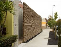 outdoor wood wall this stacked wood wall this totally hip garden by sebastian