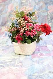 silk flower home decor arrangement on soft spring toned background