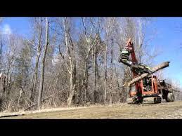 tmk tree shear with hks tilt rotator on kubota 080