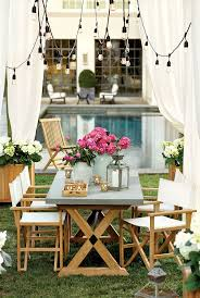 34 best picnic tables images on pinterest picnics outdoor suzanne kasler s dreamy stone topped outdoor dining table is the centerpiece of this backyard space