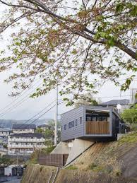 striking ms house ingeniously adapted to a sloping site in mishima