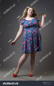 young beautiful happy blonde plus size stock photo 582496114