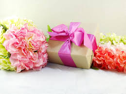 beautiful gifts gifts and beautiful bouquet of flowers for mom stock image image
