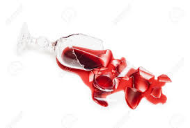 broken glass of wine poured red wine like blood isolated on