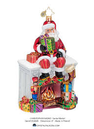 decorating colorful santa mantel by christopher radko for