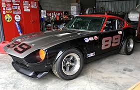 datsun race car you need this datsun 240z wearing torq thrust wheels news