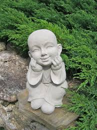 boy statue buddhist monk pupil of buddha garden statue