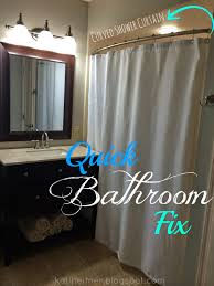 bathroom sink vanity with vanity mirror and wall sconces plus curved curtain rod