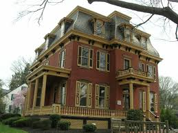 gambrel style homes exterior paris building with slate mansard roof and brown paint