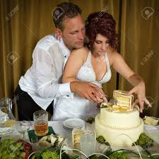 wedding cake cutting and groom cutting the wedding cake stock photo picture and
