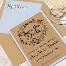 sky blue rustic wreath wedding day invitation flower motive