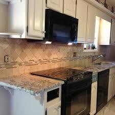 tile backsplash for kitchens with granite countertops affordable cabinets cabinet refacing doors metal distressed