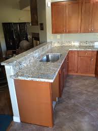 maple cinnamon shaker kitchen cabinets and african persa granite