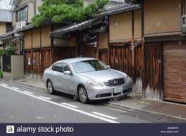 nissan car a nissan car parked in a street in kyoto japan stock photo